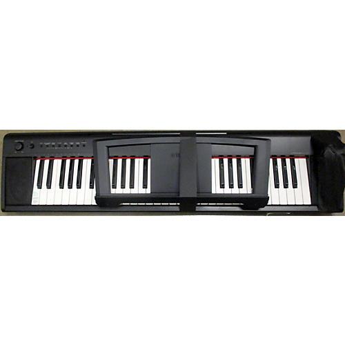Used yamaha piaggero np11 portable keyboard guitar center for Yamaha np11 piaggero