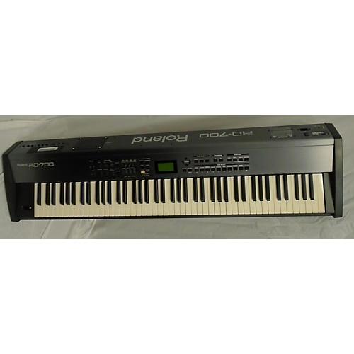 used roland rd700 keyboard workstation guitar center. Black Bedroom Furniture Sets. Home Design Ideas