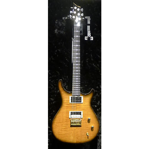 In Store Used Used ZANE FT-22 Trans Gold Solid Body Electric Guitar-thumbnail