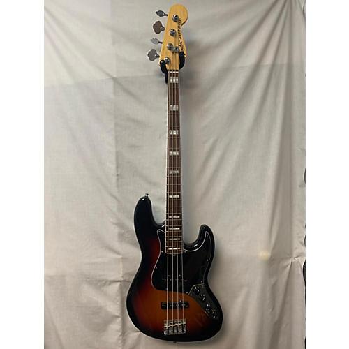 used fender american deluxe jazz bass electric bass guitar 3 tone sunburst guitar center. Black Bedroom Furniture Sets. Home Design Ideas
