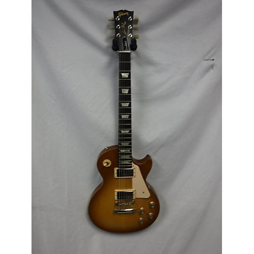 used gibson les paul tribute solid body electric guitar honey burst guitar center. Black Bedroom Furniture Sets. Home Design Ideas